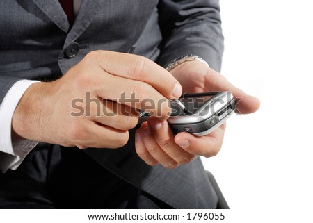 detail of an executive handling one pda - stock photo