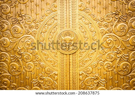 Detail of an intricately designed Asia brass door - stock photo