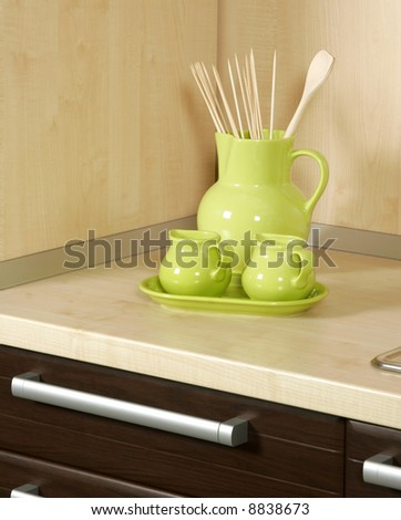 Detail of an modern kitchen with ceramic cups - stock photo