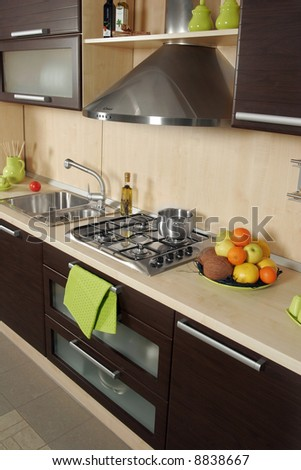 Detail of an modern kitchen with stove and fruits - stock photo