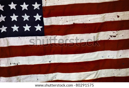 Detail of an old and ripped USA flag - stock photo