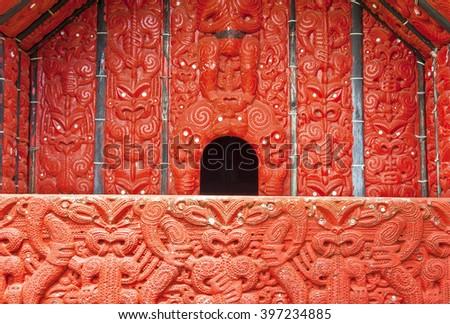 Detail of an old beautiful maor templei carving, Rotorua, New Zealand - stock photo