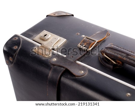 Detail of an old black vintage leather suitcase with straps and locks on a white background - stock photo
