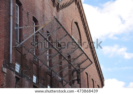 Detail of an old brick factory and metal grating in Malden, Massachusetts