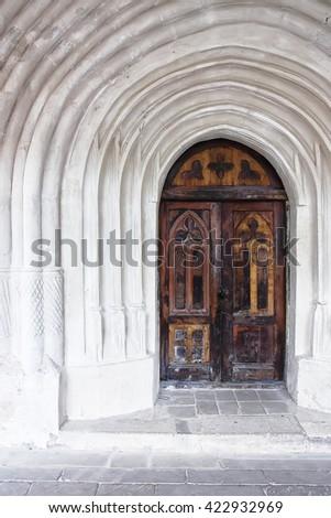 detail of an old church or castle door. Old wooden door - stock photo