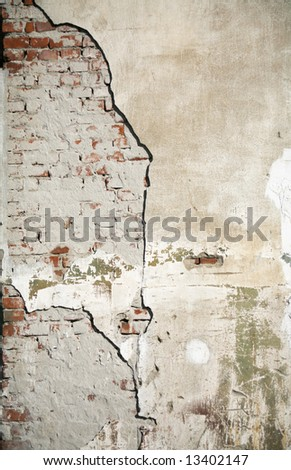 Detail of an old cracked wall - stock photo
