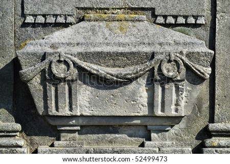 detail of an old gravestone - stock photo