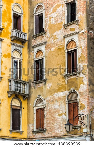 Detail of an old house's wall in Venice, Italy - stock photo