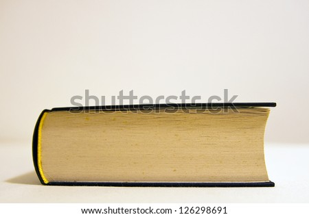 Detail of an old isolated book. - stock photo