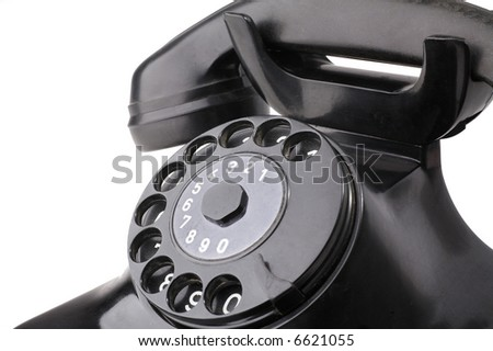 Detail of an old rotary telephone isolated on white