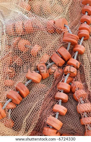 Detail of an old traditional fishing net - stock photo