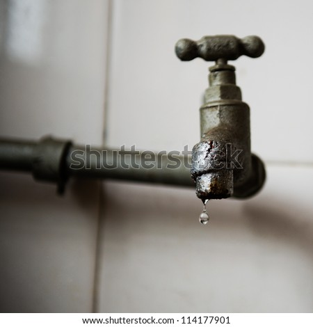 Detail of an old type water tap. - stock photo