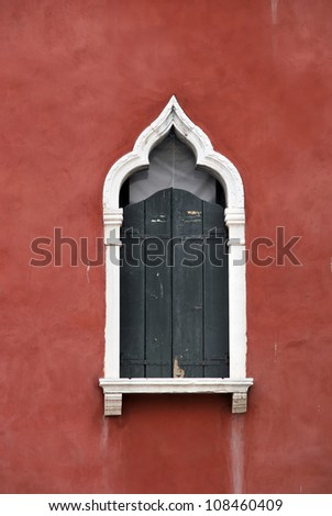 Detail of an old venetian style window. Venice. Italy - stock photo