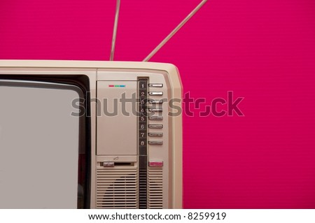 Detail of an old vintage tv set against pink wall - stock photo