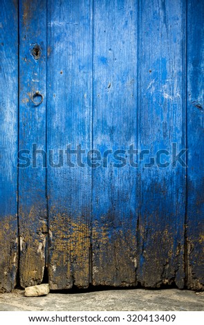 Detail of an old wooden door with scratched blue paint - stock photo