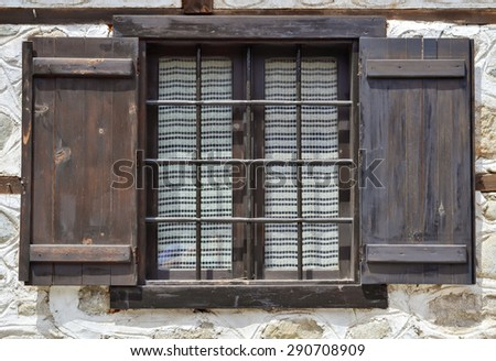 Detail of an old wooden window of a traditional house in Bulgaria