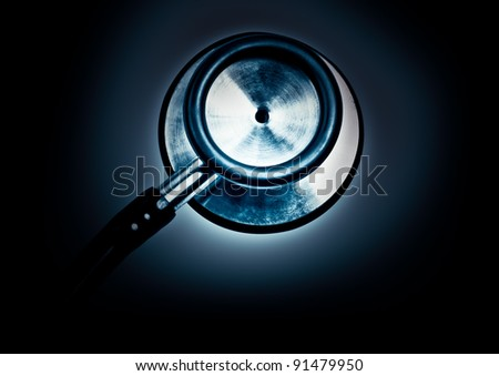 Detail of an stethoscope with high contrast lighting in dark blue shades - stock photo