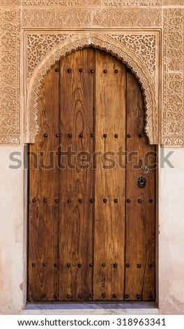 Detail of ancient door in Alhambra UNESCO site - Spain, decorations 800 years old