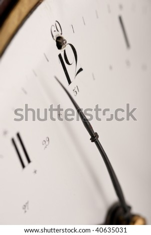 Detail of antique clock with Arabic numeral, macro lens