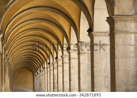Detail of arches and ceiling of building in the ancient walled city of Lucca, Italy