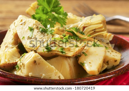 detail of artichokes portion, served on a plate - stock photo