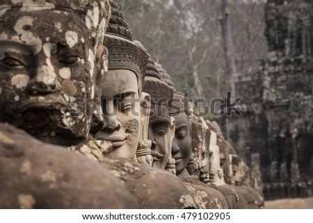 Detail of Asura Guardians heads in the bridge on the South Gate of Angkor Thom. Siem Reap, Cambodia
