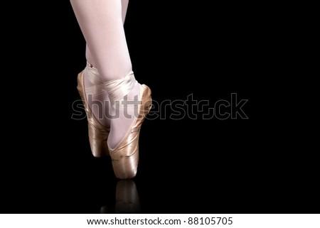 detail of ballet dancer feets on black background - stock photo