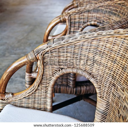 Detail of  bamboo chair in patio - stock photo