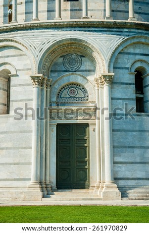 Detail of Baptistery on famous Piazza dei Miracoli, Pisa, Italy - stock photo