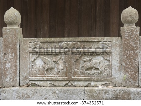 Detail of bas reliefs with designs from nature from the But Thap Pagoda, Vietnam - stock photo