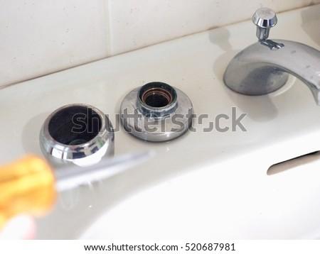 Detail Of Bathroom Sink Basin Tap Repair