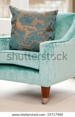Detail of beautiful turquoise armchair - stock photo