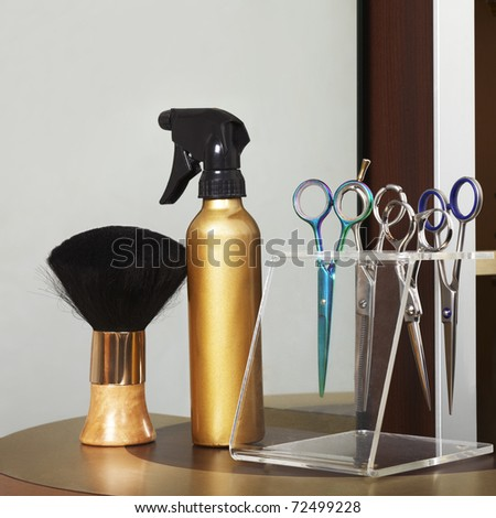 Detail of beauty salon. Hairdresser tools. Focus mostly on scissors - stock photo