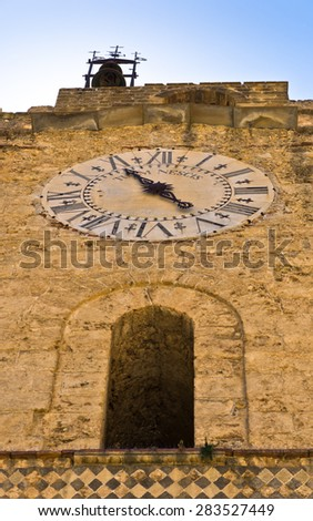 Detail of bell and clock tower at Monreale cathedral, near Palermo, Sicily, Italy