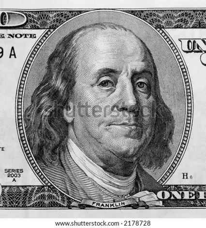 Detail of Benjamin Franklin's portrait on one hundred dollar bill. - stock photo
