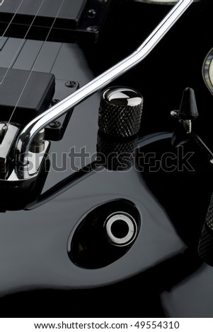 Detail of black electric guitar with whammy bar - stock photo