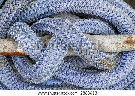 Detail of Blue Boat Rope on Cleat - stock photo