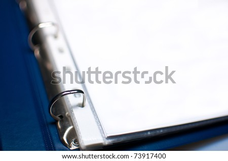 Detail of Blue Open File Folder With Blank Papers, shallow depth of field - stock photo
