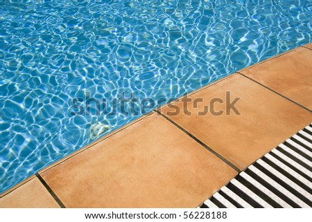 Detail of blue swimming pool side at a spa - Lifestyle and luxury concept - stock photo