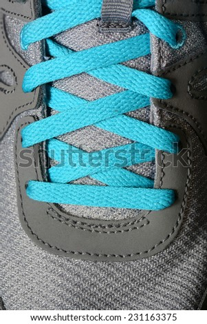 Detail of blueshoe laces on running shoes - stock photo