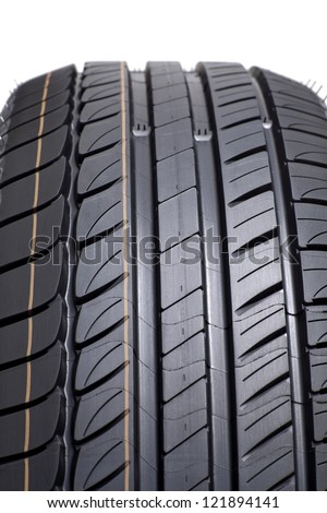 Detail of brand new tire, isolated on white background - stock photo