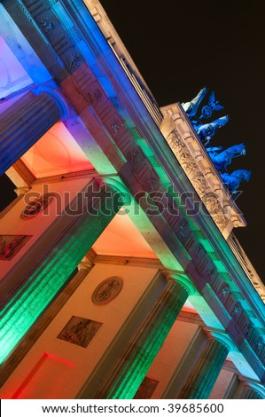 detail of Brandenburg Gate lit by colorful lights, Berlin, Germany - stock photo