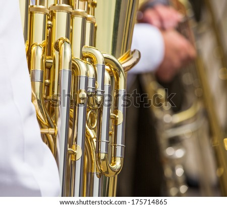 Detail of brass bass tuba or bugle with valves