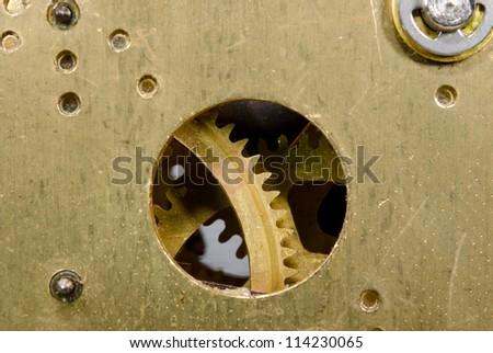 detail of brass clockwork - stock photo