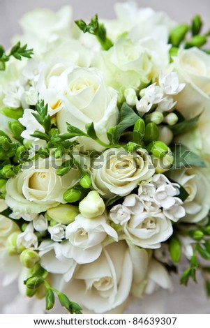 Detail of bridal bouquet of white roses. - stock photo