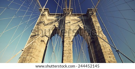 detail of  Brooklyn Bridge with blue sky, New York City, USA,  vintage style  - stock photo