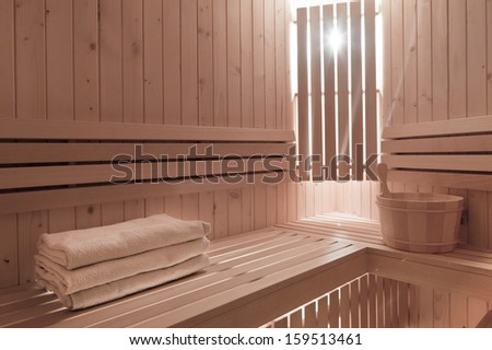 Detail of bucket and  towels in a wooden sauna room - stock photo