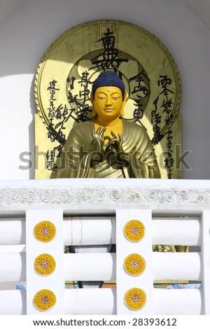detail of buddha statue - stock photo
