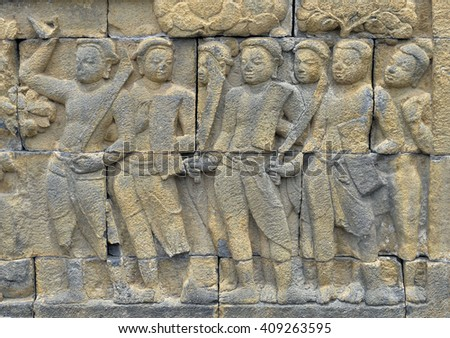 Detail of Buddhist carved relief in Borobudur temple in Yogyakarta, Java, Indonesia.. - stock photo