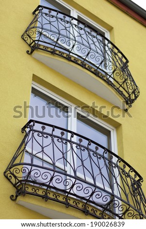 detail of building and decorative metal railing window - stock photo